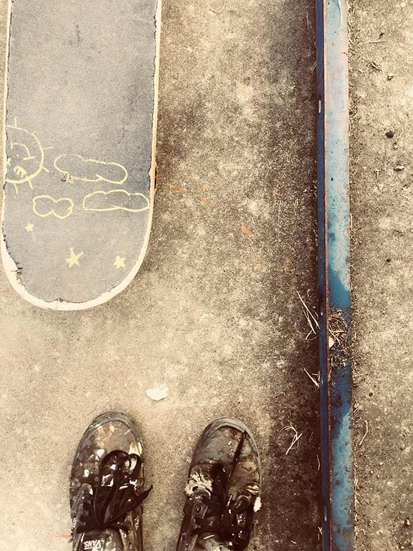 Shoes and a skateboard in sepia tone