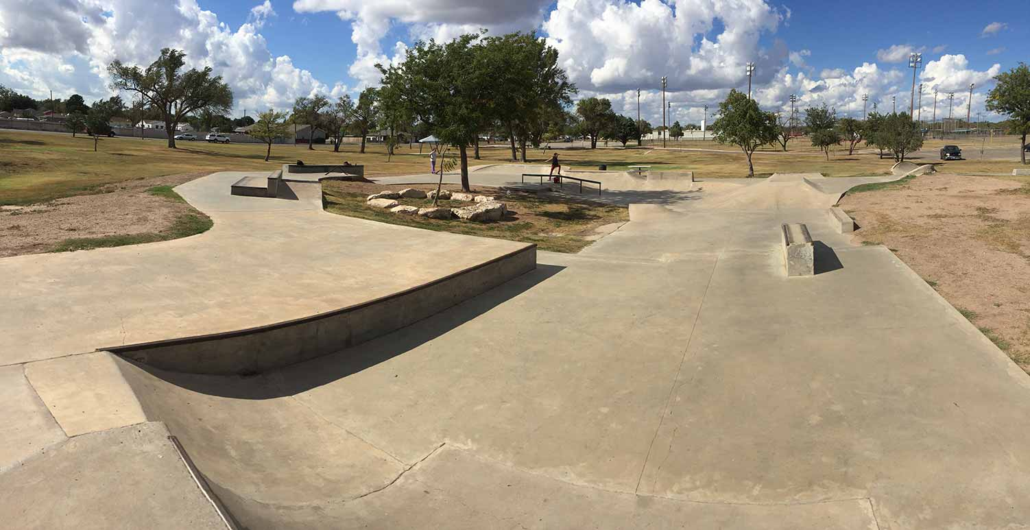 Skatepark that is an undulating cement strip bent into a circle