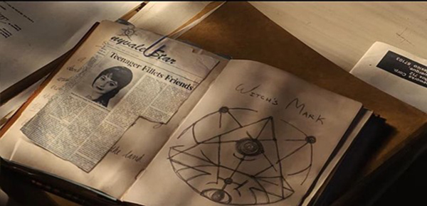 Scarapbook of newspaper clipping and demonic symbol